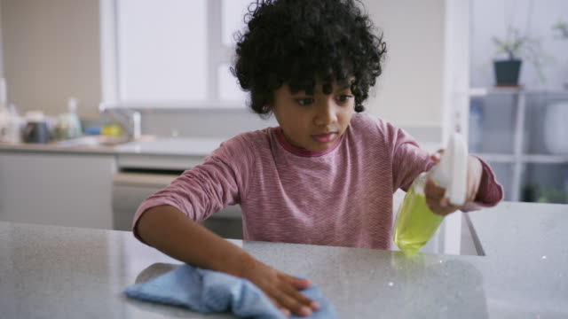 he's our defender against germs - kitchen worktop stock videos & royalty-free footage