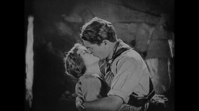1925 hesitant man congratulates couple on new romance during cave exploration - black and white stock videos & royalty-free footage