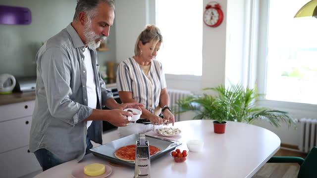 heterosexual couple preparing food - 50 59 years stock videos & royalty-free footage