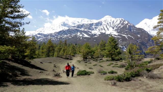 Heterosexual Couple Walking in Annapurna Trek, Nepal