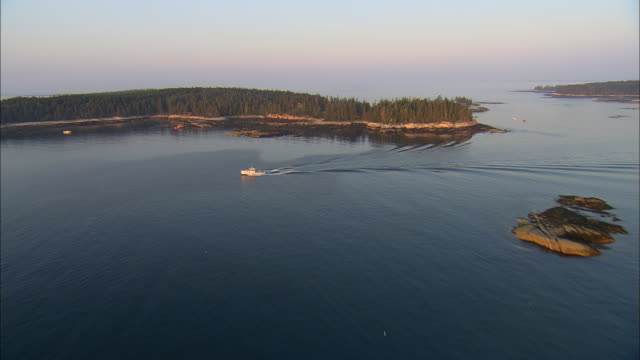 low aerial, hewet and mink islands at sunrise, maine, usa - maine stock videos & royalty-free footage