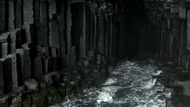 hexagonal basalt columns in fingal's cave, scotland - rock formation stock videos & royalty-free footage