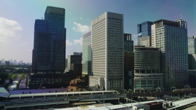 hi rise office buildings facing tokyo station - office block exterior点の映像素材/bロール