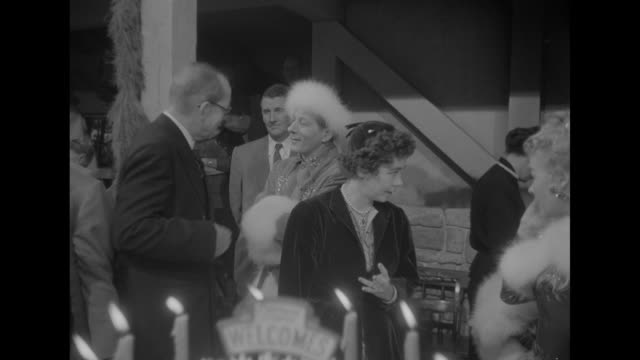 entourage arrives on set / ms king paul i and queen frederica walk by large cake with burning candles / king talks with danny kaye in costume queen... - king royal person stock videos & royalty-free footage