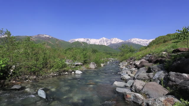 hida mountains, northern alps and melted snow melted snow river / hakuba, nagano prefecture, japan  - nagano prefecture stock videos & royalty-free footage