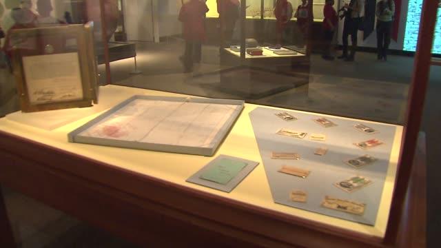 vídeos de stock e filmes b-roll de hidden treasures of the 1893 chicago world's fair exhibit opened up at the field museum in chicago 1893 world's fair entrance tickets in display case... - cristaleira