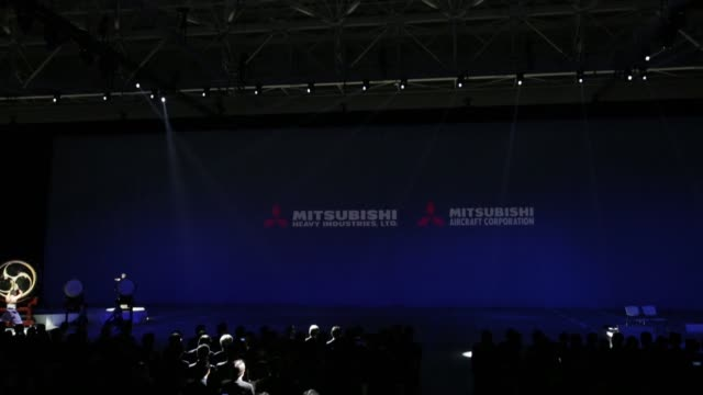 hideaki omiya chairman of mitsubishi heavy industries ltd speaks during a rollout ceremony for the mitsubishi regional jet passenger aircraft... - leitende person stock-videos und b-roll-filmmaterial