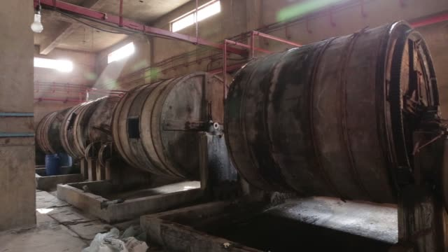 Hides sit in piles at the Sheong Shi Tannery in Kolkata West Bengal India on Tuesday Dec 26 Close up hides sit in piles Wooden tanning drums operate...