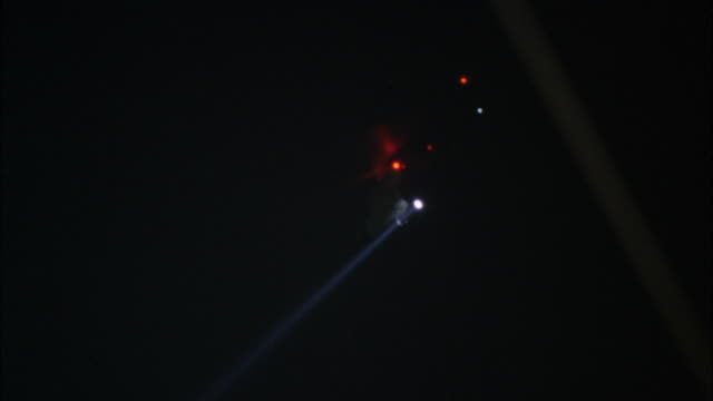 pov hiding from narrow-beam white light and flashing red lights of weaponry laser sights sweeping darkened room from open door / los angeles, california, united states - hiding stock videos & royalty-free footage
