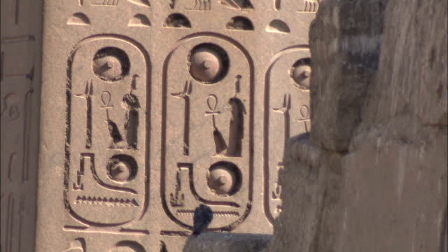 hieroglyphics adorn a stone structure. - symbol stock videos & royalty-free footage