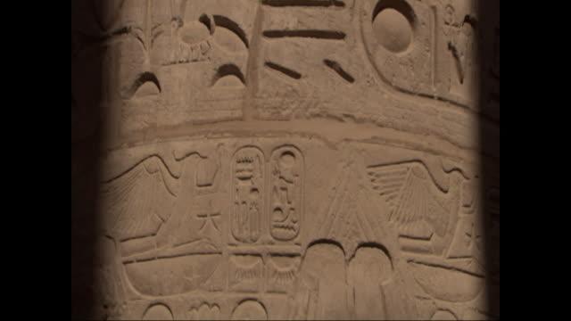 hieroglyphics cover a pillar in egypt. - geroglifico video stock e b–roll