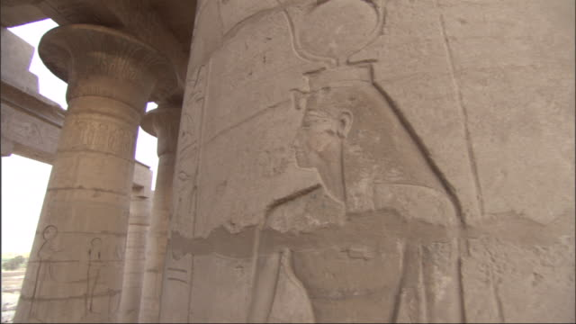 hieroglyphics cover columns and ceiling supports at the ruins of an ancient egyptian building. - column stock videos & royalty-free footage