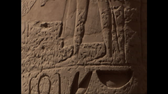 hieroglyphics depict ancient egyptian life. - geroglifico video stock e b–roll