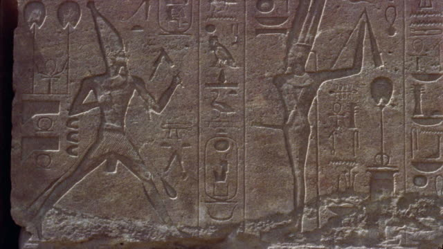 cu pan hieroglyphics on wall/ egypt - engraved image stock videos and b-roll footage
