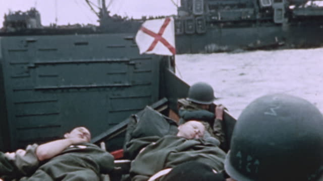 higgins boat flying the red cross flag and carrying wounded soldiers approaching uss lubbock during world war ii pacific campaign - iwo jima island stock videos & royalty-free footage