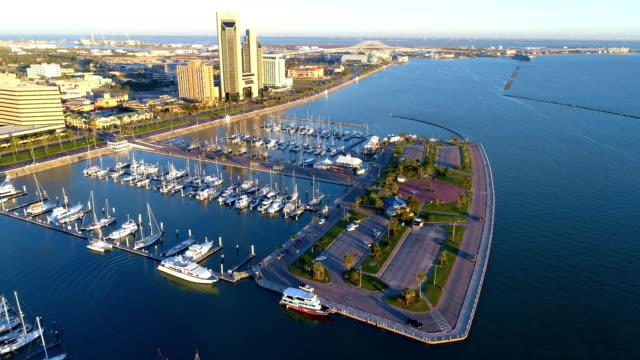 high above corpus christi , texas , usa harbor and marina t-head aerial drone view - corpus christi texas stock videos & royalty-free footage