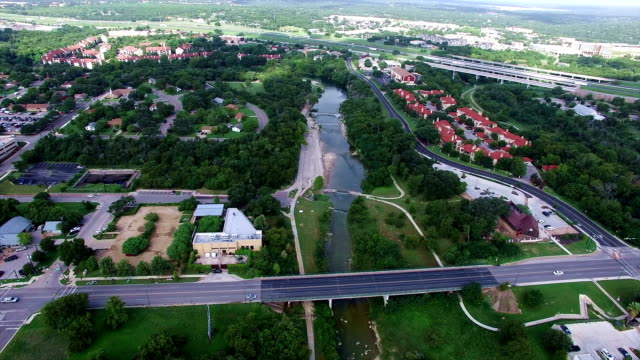 high above georgetown texas aerial fly over with bridge community and university area - georgetown texas stock videos & royalty-free footage