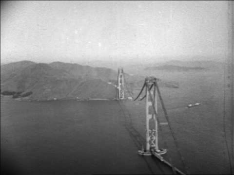 vídeos de stock, filmes e b-roll de aerial high above golden gate bridge construction / san francisco / newsreel - pacífico norte