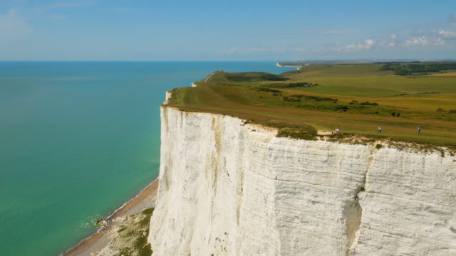 High aerial drone footage of walkers on the white cliffs, Seven Sisters