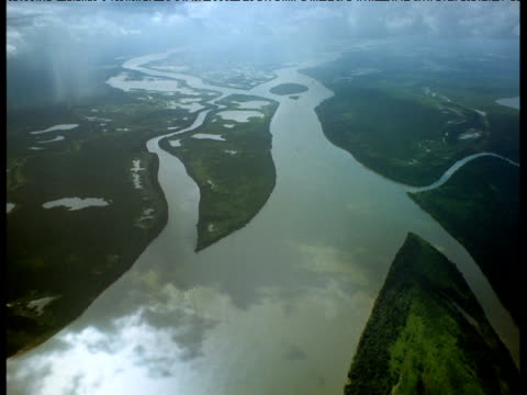 high aerial of mighty amazon river snaking its way through jungle - variation stock videos & royalty-free footage
