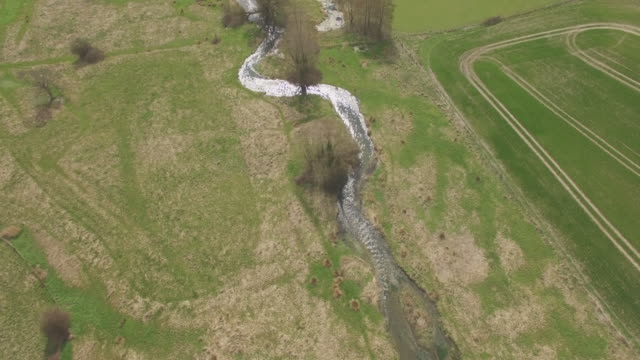 high aerial track along meon river - kreidefelsen stock-videos und b-roll-filmmaterial