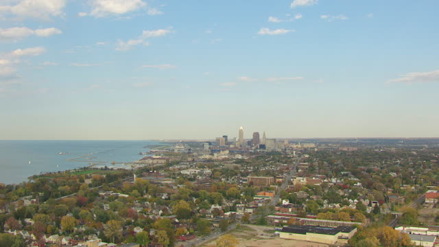 high ws aerial view approaching downtown with lake erie / cleveland, ohio, united states - cleveland ohio stock videos and b-roll footage