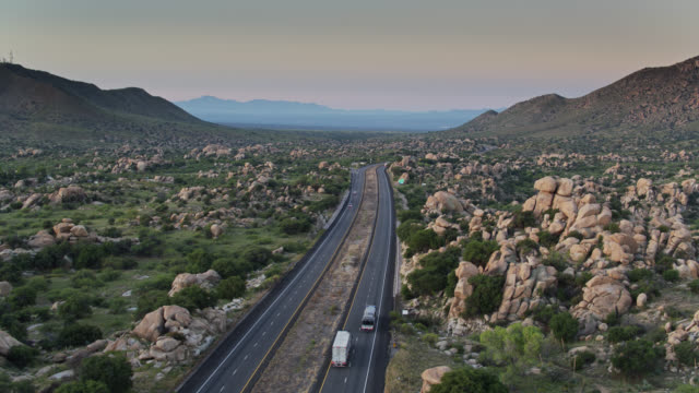 high aerial view of interstate 10 in texas canyon, az at dawn - american interstate stock videos & royalty-free footage