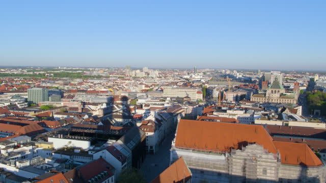 high altitude flight through church of our lady towers in morning light - rathaus stock videos & royalty-free footage