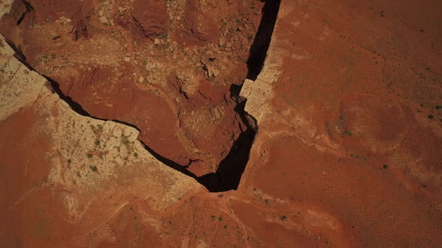 High altitude flying tilt camera to reveal canyon at Cannyonlands National Park Utah