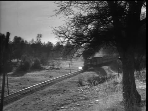 b/w high angle 1800s passenger steam train passing in countryside - neunzehntes jahrhundert stock-videos und b-roll-filmmaterial