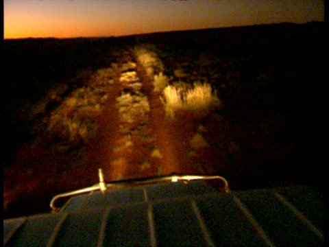 MS High angle, POV of 4WD roof, along desert at night