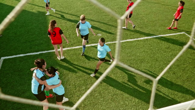 high angle action close-up of hispanic female celebrating a goal - football team stock videos & royalty-free footage