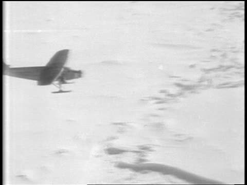air high angle admiral byrd's airplane flying over snowy plain / antarctica - 1929 stock videos and b-roll footage