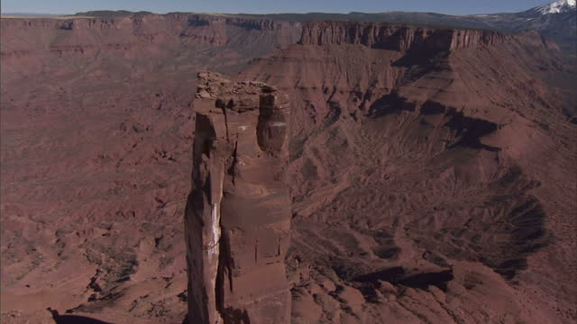 High Angle aerial - Buttes rise above the valley floor in Monument Valley / Arizona, USA