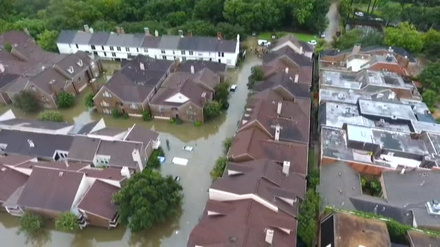 high angle aerial from a drone flying over flooded neighborhood with the flooding after hurricane harvey in houston texas - environment or natural disaster or climate change or earthquake or hurricane or extreme weather or oil spill or volcano or tornado or flooding stock videos & royalty-free footage