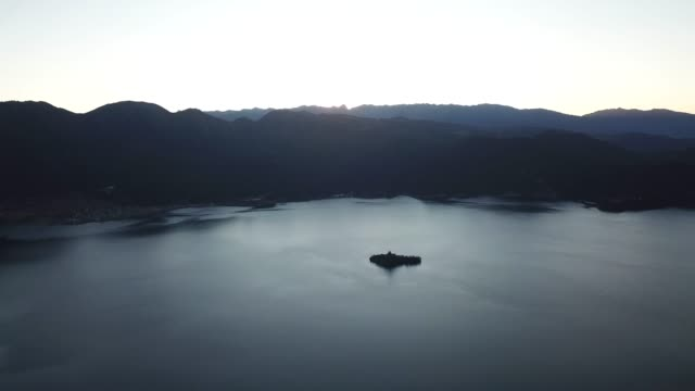 high angle aerial panoramic view of lugu lake in china at sunrise - us navy stock videos & royalty-free footage