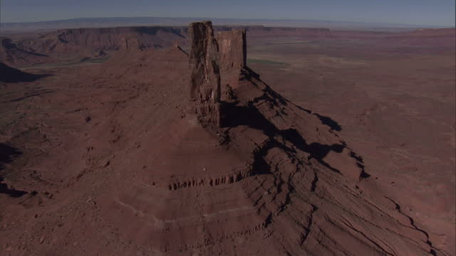 High Angle aerial - Red buttes rise from the valley floor in Monument Valley / Arizona, USA
