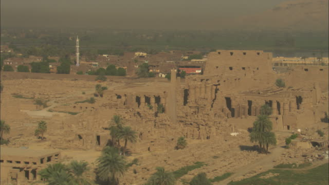 high angle, aerial - sandstone historical ruins with large pillars stand out in the egyptian nile delta - sandstone stock videos & royalty-free footage