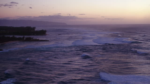 high angle aerial shot of the ocean during dusk - kahuku stock videos & royalty-free footage