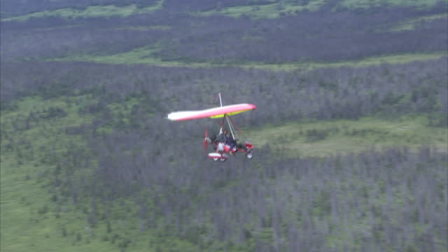 """""""high angle aerial tracking-right-an ultralight descends lower over the kenai peninsula. / kenai peninsula, alaska, usa"""" - kenai peninsula stock videos & royalty-free footage"""