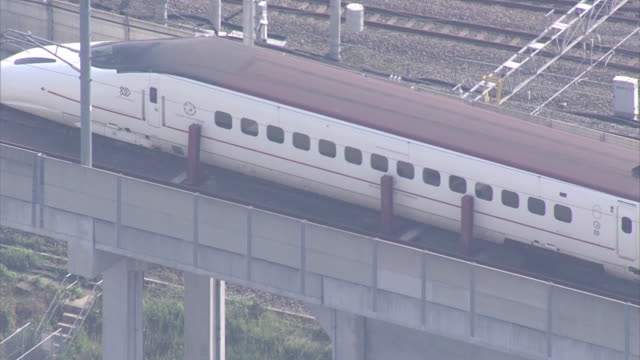 high angle aerial view of a derailed carriage of kyushu shinkansen bullet train stopped near kumamoto station after consecutive earthquake hits... - kyushu shinkansen stock videos & royalty-free footage