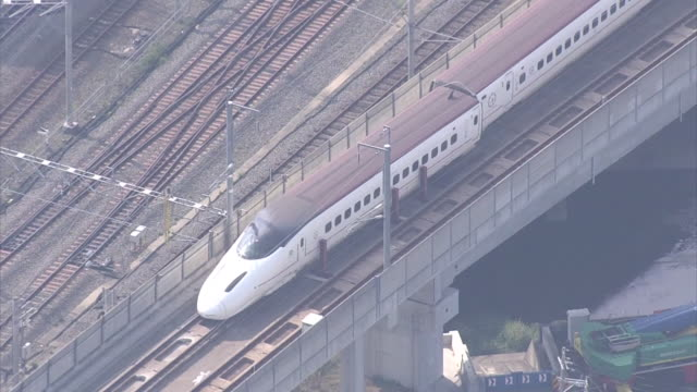 high angle aerial view of a derailed carriage of kyushu shinkansen bullet train stopped near kumamoto station after consecutive earthquake hits... - kyushu shinkansen stock videos and b-roll footage