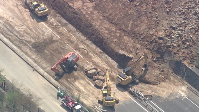 high angle aerial view of a landslide blocked part of oita expressway near yufudake parking area after consecutive intense earthquakes hit... - rebuilding stock videos and b-roll footage