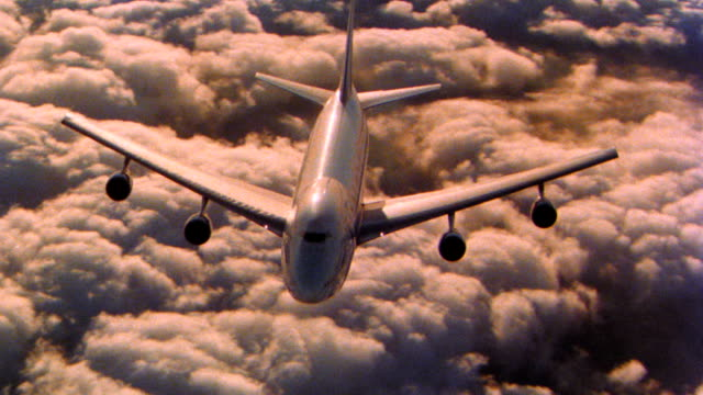 aerial high angle aircraft point of view around 747jet flying over sea of clouds - air to air shot stock videos and b-roll footage