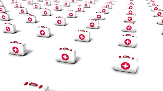 high angle arc pull back revealing endless first aid kits - första hjälpen sats bildbanksvideor och videomaterial från bakom kulisserna