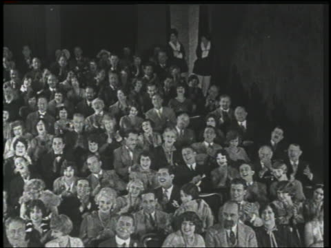 b/w 1926 high angle audience in theater laughing + clapping - 1926 stock videos & royalty-free footage