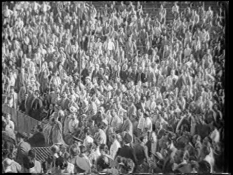 b/w 1951 high angle audience standing in stadium after boxing match / berlin / newsreel - 1951 stock videos & royalty-free footage