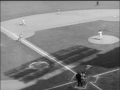 vídeos y material grabado en eventos de stock de b/w 1955 high angle batter running to first base / man running home from third base / world series - uniforme de béisbol