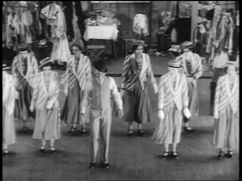 b/w 1932 high angle bill robinson dancing on stage with chorus line of women behind him / feature - 1932 stock videos and b-roll footage