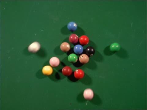 high angle billiard ball setup getting broken - キューボール点の映像素材/bロール